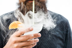Bearded man with alcoholic beverage Stock Photo
