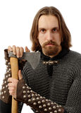 Bearded man in amour, holding an axe. And looking angrily Royalty Free Stock Photography