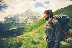 Bearded Man with backpack hiking Travel Lifestyle. Concept mountains on background Summer journey adventure vacations outdoor stock images