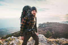 Bearded Man backpacker hiking in mountains. Travel Lifestyle concept adventure active vacations outdoor mountaineering sport Royalty Free Stock Photography