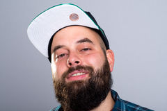Bearded man with baseball cap is smiling Royalty Free Stock Image