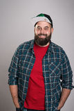 Bearded man with baseball cap is smiling Stock Photos