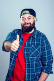 Bearded man with baseball cap with thumb up Royalty Free Stock Photography