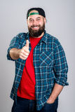 Bearded man with baseball cap with thumb up Royalty Free Stock Images