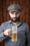 Bearded man with beer. royalty free stock photo
