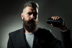 Bearded man with beer tin can Royalty Free Stock Photos