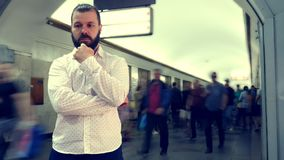 Bearded man. Big city. Many people pass by a person. Life style. One man. Slow motion. Portrait. stock video