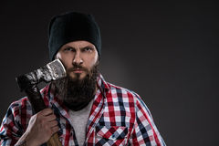 Bearded man in a black hat holding a old ax Royalty Free Stock Photography