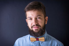 Bearded man in a blue shirt Royalty Free Stock Photos