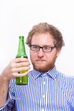 Bearded man with a bottle of beer Stock Photo