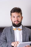 Bearded man with a bow tie Stock Image