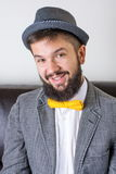 Bearded man with a bow tie Royalty Free Stock Photos