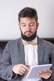 Bearded man with a bow tie Royalty Free Stock Photography