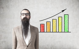 Bearded man and bright graphs Royalty Free Stock Image