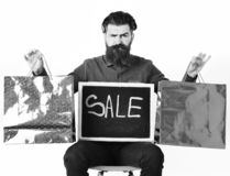 Bearded man, brutal caucasian hipster with moustache holding shopping packages. Bearded man, long beard. Brutal caucasian squinting hipster with moustache stock photos