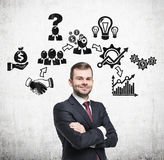Bearded man and business icons on concrete Stock Images