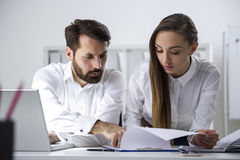 Bearded man, businesswoman and a document Stock Image