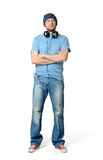 Bearded man in a cap and headphones on white background Royalty Free Stock Photography