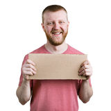 Bearded man with a cardboard sign in his hand Royalty Free Stock Image