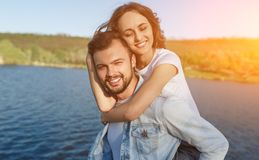 Beautiful happy couple in sunny nature stock photo