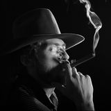 Bearded man with  a cigar Stock Image