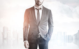 Bearded man in a city. Close up of an unrecognizable bearded businessman standing against a city panorama. Double epxosure Royalty Free Stock Images