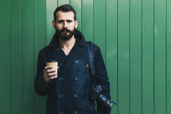 Bearded man with coffee cup and camera Royalty Free Stock Image
