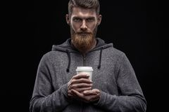 Bearded man with coffee in hand royalty free stock photos