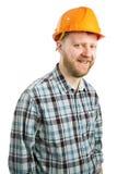 Bearded man in a construction helmet royalty free stock photos