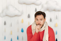 Bearded man coughing at home Stock Photography