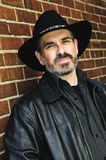 Bearded man in cowboy hat. Man with beard in cowboy hat and leather jacket Stock Photos