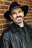 Bearded man in cowboy hat Royalty Free Stock Image