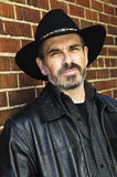 Bearded man in cowboy hat Stock Photos
