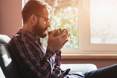 Bearded man with cup of coffee or tea Royalty Free Stock Photography