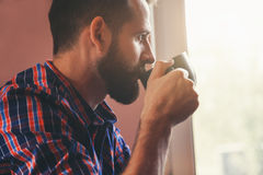 Bearded man with cup of morning coffee Stock Photos