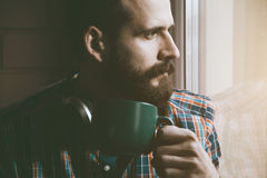 Bearded man with cup of morning coffee or tea Stock Photography