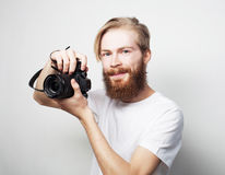 Bearded man with a digital camera Royalty Free Stock Image