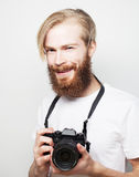 Bearded man with a digital camera Royalty Free Stock Photo