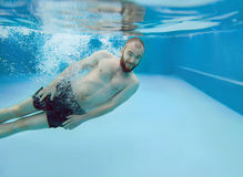 Bearded man dives underwater Stock Photography
