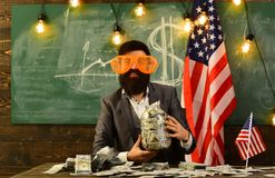 Bearded man with dollar money for bribe. Income planning of budget increase policy. Economy and finance. Patriotism and Royalty Free Stock Photos