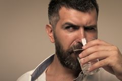 Bearded man drink water. Thirst, dryness, drought. Water consumption concept. Health diet healthy dieting Royalty Free Stock Photos