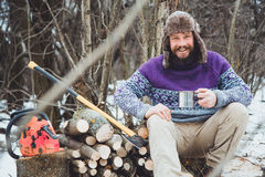 Bearded man drinking tea in the forest. Royalty Free Stock Photos