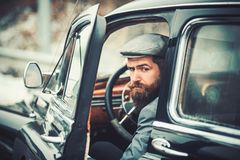 Bearded man driver outdoors in retro car. Bearded man driver outdoors in retro car stock photography