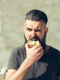 Bearded man eating apple Stock Photo