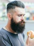 Bearded man eating apple Stock Photos