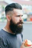 Bearded man eating apple Royalty Free Stock Photo