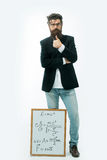 Bearded man with einstein formula and newtons law Stock Image