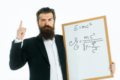 Bearded man with einstein formula and newtons law Royalty Free Stock Photos