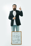 Bearded man with einstein formula and newtons law Royalty Free Stock Images