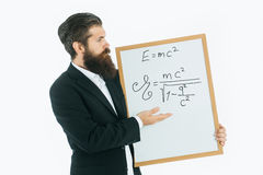 Bearded man with einstein formula and newtons law Stock Images